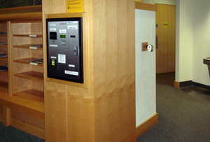 Cash to card machine in wall on first floor of library