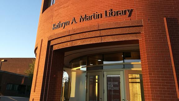 exterior of library focusing on gold front doors