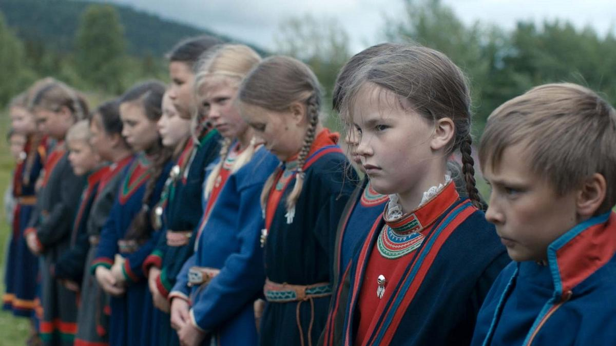 A still image from Sami Blood film - a row of children dressed in traditional sami garb