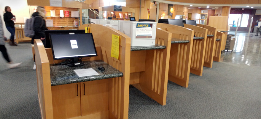 Printers on first floor of library on and near the circulation desk